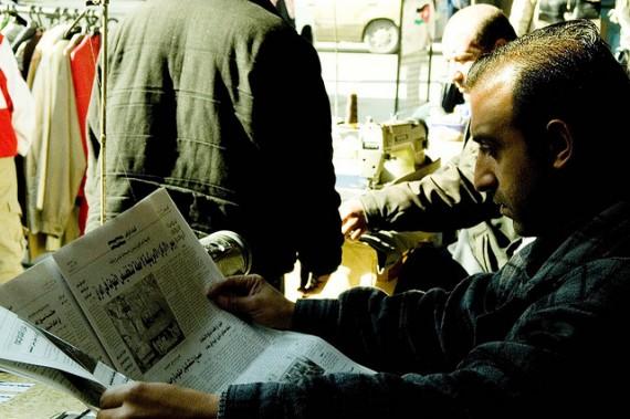 Newspaper Reader in Amman